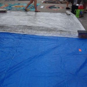 tarps covering art pieces.