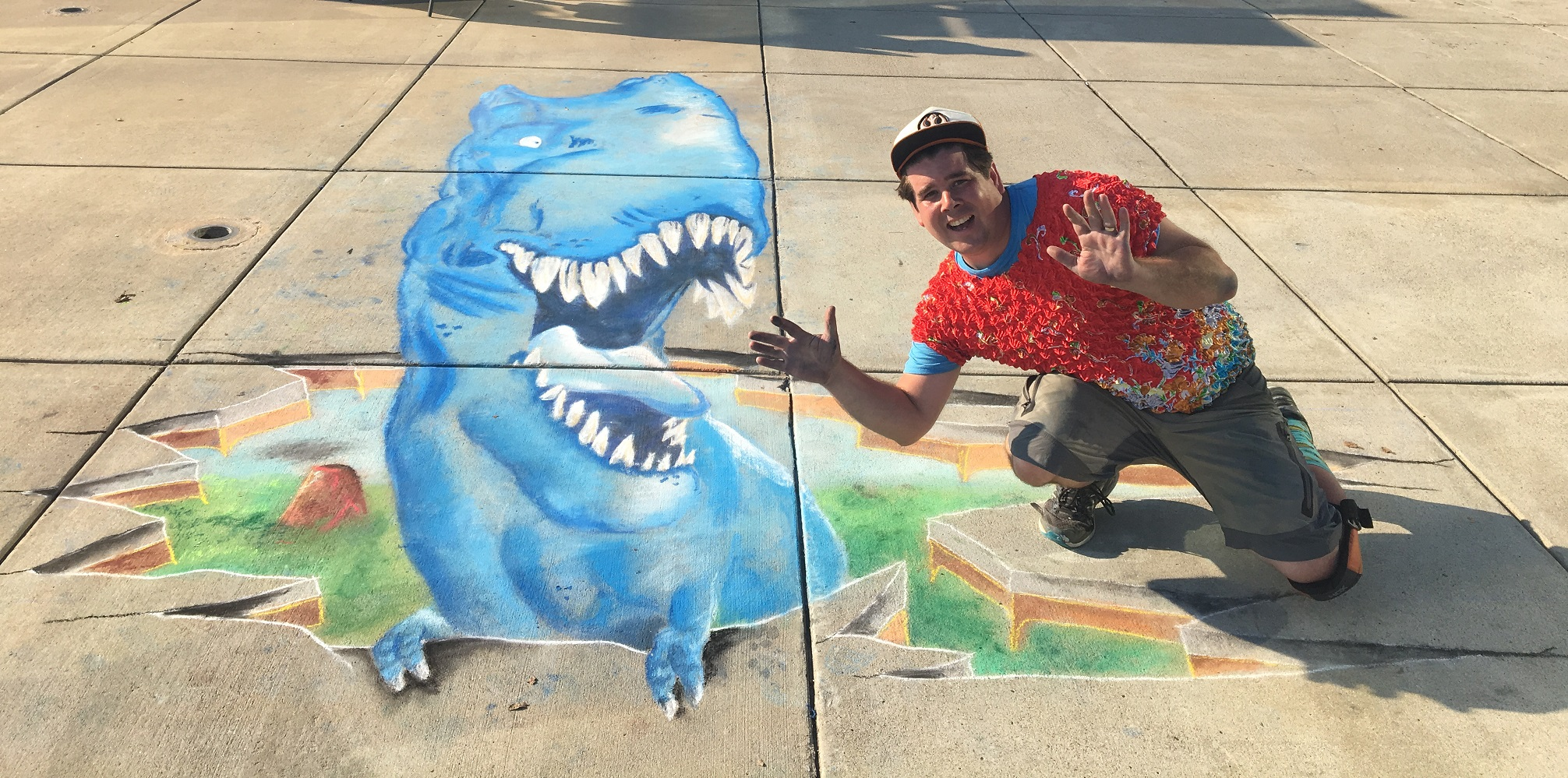 Zach poses with a T-Rex Dinosaur 3D Chalk Art